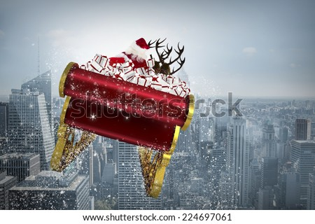 Santa flying his sleigh against cityscape - stock photo