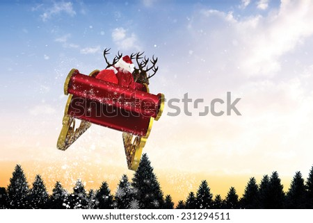 Santa flying his sleigh against snow falling on fir tree forest - stock photo