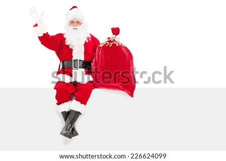 Santa gesturing happiness seated on a panel isolated on white background - stock photo