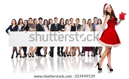 Santa girl and large group of business people holding empty banner   - stock photo