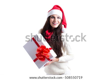 Santa girl holding gift on white background. Isolated.