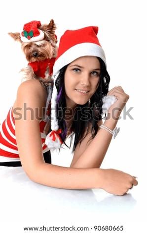 Santa girl holding small dog, isolated on white background - stock photo