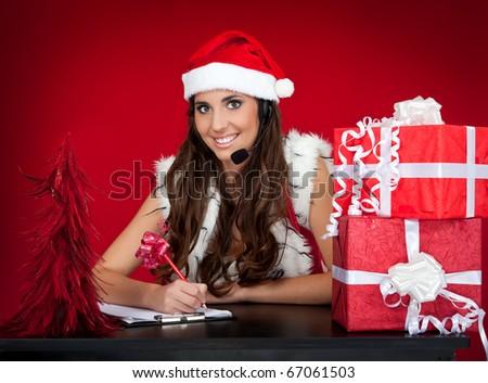 santa girl making list of christmas present wishes - stock photo