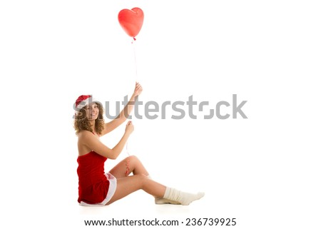 Santa girl sitting with heart shaped balloon