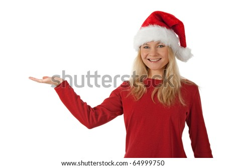 Santa girl wearing Christmas hat, holding hand palm up, ready to hold a present. - stock photo