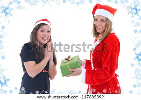 Santa gives present for happy girl over background with snowflakes