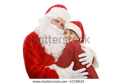 Santa giving a hug to an adorable little boy.  Isolated on white. - stock photo
