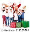 Santa giving Christmas gifts to a group of children - isolated over white - stock photo