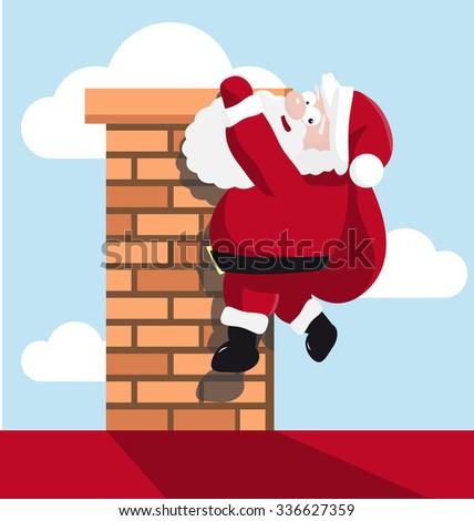 Santa hanging on the chimney - stock photo