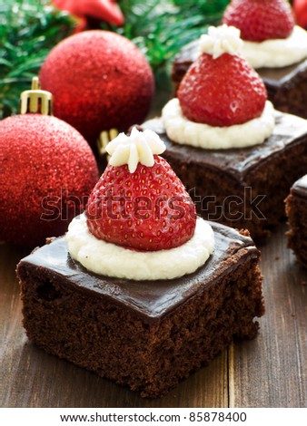 Santa hat brownie bites on the wooden background. Shallow dof. - stock photo
