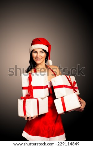Santa hat Christmas woman holding christmas gifts smiling happy and excited. Cute beautiful multi-racial Caucasian Asian santa girl isolated on black background. - stock photo