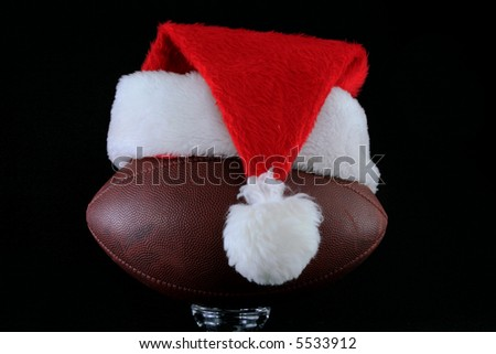 Santa hat on American Football - stock photo