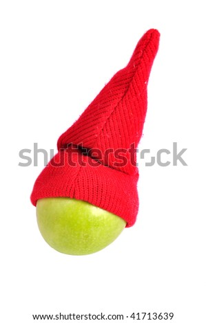 santa hat on an green apple, isolated on white - stock photo