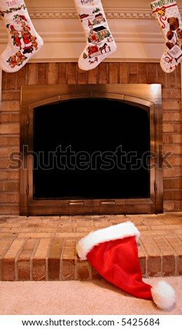 Santa Hat on Fireplace Hearth at Christmas - stock photo