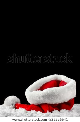 Santa hat on snow. Christmas or New Year decoration