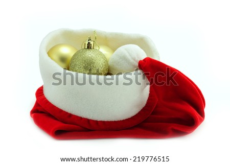 santa hat with Christmas balls isolated on white - stock photo