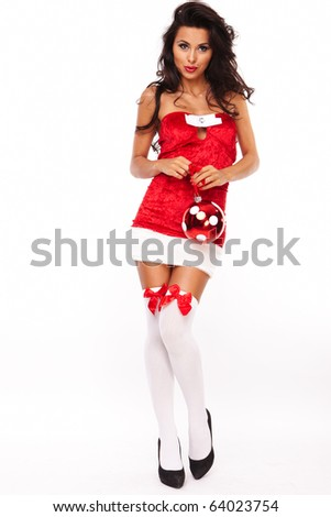 santa helper girl on white background with long hair and red balls - stock photo