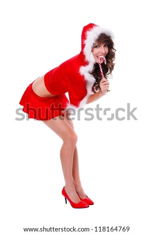 Santa helper in sexy clothes tasting lollypop - stock photo