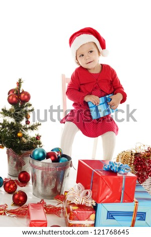 Santa helper with gift sitting on the chair