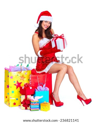Santa helper woman with shopping bags and gifts - stock photo