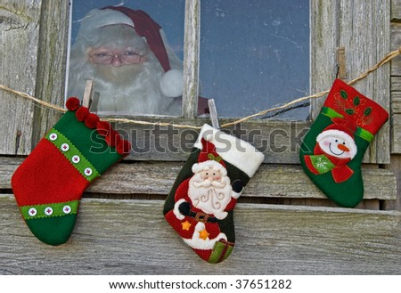 santa in old window with stockings