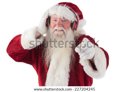 Santa is listening some music on white background - stock photo