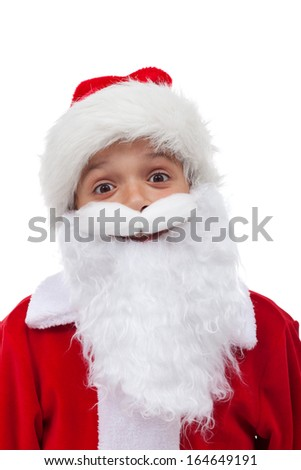 Santa is so happy - boy in christmas suit grinning behind white beard, isolated - stock photo