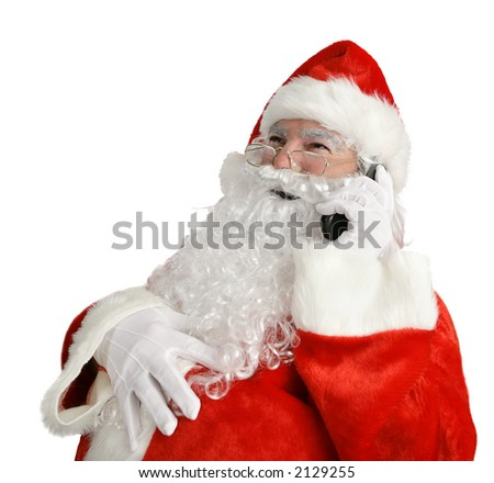 Santa laughing out loud as he talks on his cell phone.  Isolated on white.