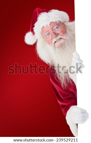 Santa looks out behind a wall against red background