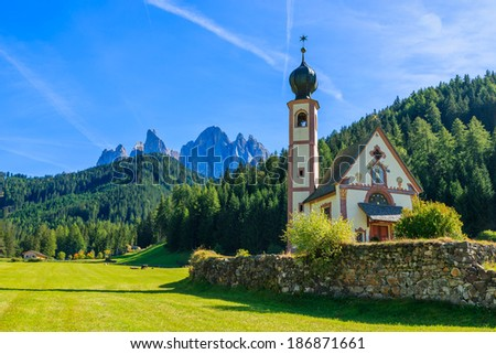 Santa Maddalena church in green alpine valley, Val di Funes, Dolomiti Mountains, Italy