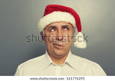 santa man thinking and looking up over dark background