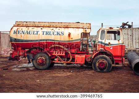 SANTA MARIA, CAPE VERDE - DECEMBER 17, 2015: Renault Cistern truck abandoned at the scrap-heap. Red rusty car - stock photo