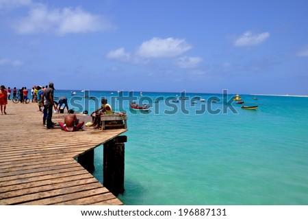 SANTA MARIA, CAPE VERDE - MAY 25: Fishermen at pier, May 25,2014 in Santa Maria, Cape Verde - stock photo