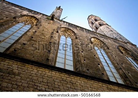 "Santa Maria del Mar is a gothic church that was built somewhere between 1300 and 1350. It is located in the ""Born"" (or ""Borne"") quarter. Here we can see one side of it, at Sombrerers street. - stock photo"