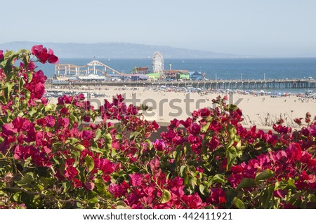 Santa Monica Beach and Pier on a hot summer day - stock photo