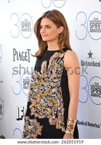 SANTA MONICA, CA - FEBRUARY 21, 2015: Stana Katic at the 30th Annual Film Independent Spirit Awards on the beach in Santa Monica.  - stock photo