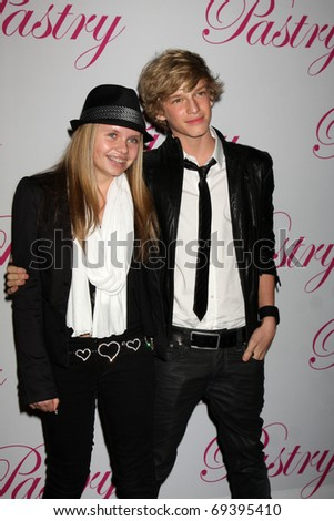 SANTA MONICA, CA - JAN 19:  Ali Simpson, Cody Simpson arrives at Cody Simpson's 14th Birthday Party at Pacific Park at Santa Monica Pier on January 19, 2011 in Santa Monica, CA