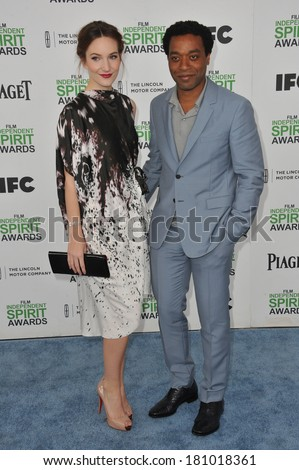 SANTA MONICA, CA - MARCH 1, 2014: Chiwetel Ejiofor & Sari Mercer at the 2014 Film Independent Spirit Awards on the beach in Santa Monica, CA.