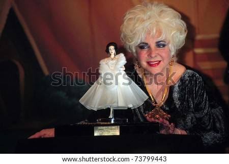 SANTA MONICA, CA - OCT 24:  Elizabeth Taylor at Dream Halloween 1998 with Elizabeth Taylor Mattel Doll  at Barker Hanger on October 24, 1998 in Santa Monica, CA - stock photo