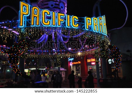 SANTA MONICA, CALIFORNIA - DECEMBER 7: Santa Monica Pier in Los Angeles, California as seen on December 7, 2012. The ferris wheel here is the world's first and only solar powered ferris wheel.  - stock photo