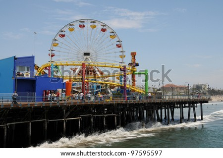 SANTA MONICA, CALIFORNIA - JUL 18: Santa Monica pier Pacific Park oceanfront amusement park's ferris wheel is the world's first and only solar powered Ferris wheel. Santa Monica Jul 18, 2009.