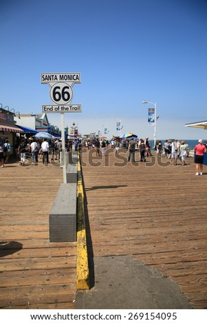 SANTA MONICA, CALIFORNIA - JULY 1: Route 66 sign on the pier on July 1, 2012 in Santa Monica, California. Old 66 was over 2,000 miles long from Chicago to Los Angeles and was decommissioned in 1984. - stock photo