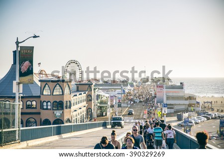 SANTA MONICA, CALIFORNIA - OCTOBER 8, 2015 : view of Santa Monica pier, California. The city has 3.5 miles of beach locations and 340 days of sunshine a year. - stock photo
