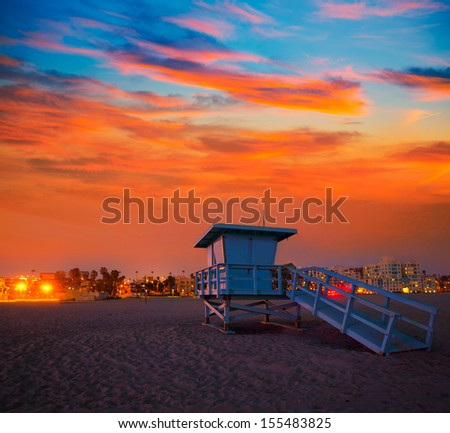 Santa Monica California sunset lifeguard tower and glowing city in USA - stock photo