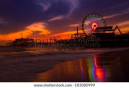 Santa Monica California sunset on Pier Ferrys wheel and reflection on beach wet sand - stock photo