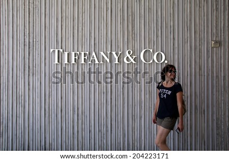 SANTA MONICA, CALIFORNIA - TUES. JUNE 24, 2014: A woman walks past a Tiffany & Co. jewelry store in Santa Monica, California, on Tuesday, June 24, 2014. - stock photo