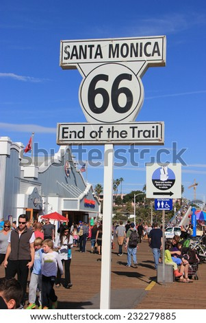 Santa Monica, California, USA - November 16, 2014: The Historic Route 66 Sign commemorates the end point of the route at Santa Monica Pier in Santa Monica, California.  - stock photo