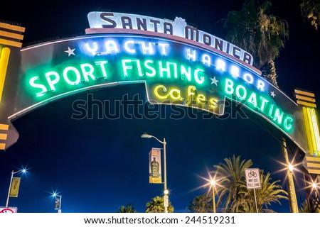 SANTA MONICA - JAN 14, 2015: Famous Glowing Santa Monica Yacht Harbor Sign - Entrance to Santa Monica Pier on Ocean Avenue in LA California at Night. Santa Monica is a beachfront city in Los Angeles. - stock photo