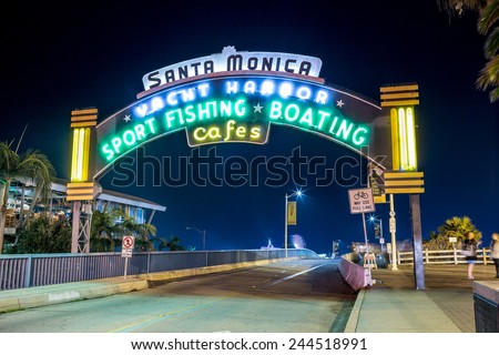 SANTA MONICA - JAN 14, 2015: Santa Monica Yacht Harbor Sign at Night - Famous Entrance to Santa Monica Pier on Ocean Avenue in LA. Santa Monica is a beachfront city in Los Angeles California. - stock photo