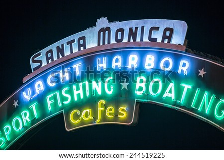SANTA MONICA - JAN 14, 2015: Santa Monica Yacht Harbor Sport Fishing and Boating Sign in Los Angeles California at Night. Santa Monica is a beachfront city in Los Angeles California. - stock photo
